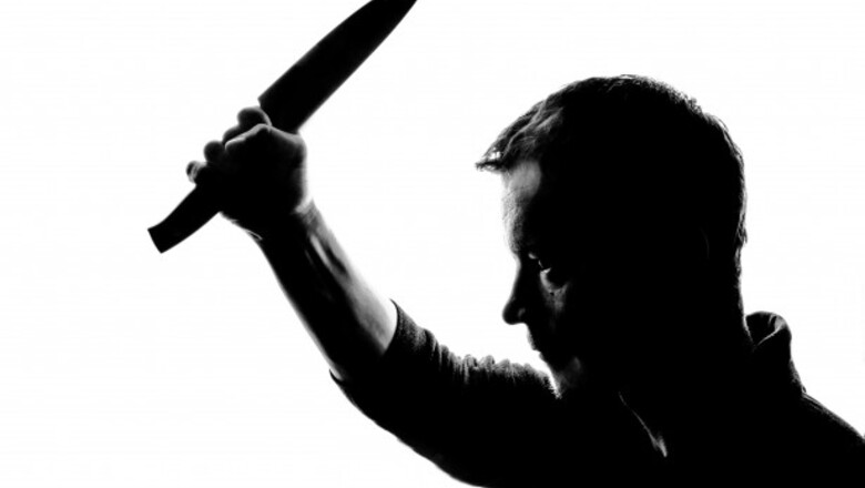 Horror silhouette of man with knife 13930710009un